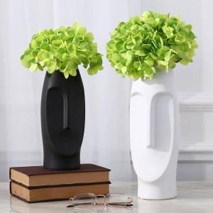 人工的な花が付いている人の表面花の花瓶の創造的で現代的な花瓶の装飾的な花瓶